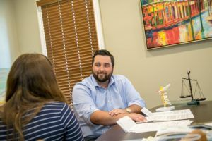 Sam Spurgeon Lawyer Client Consultation - Spurgeon Law Firm